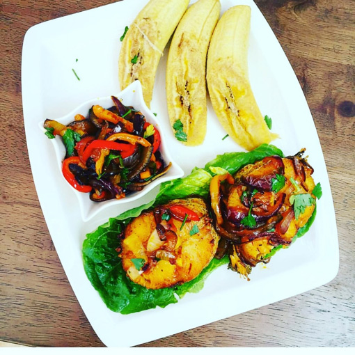 Boiled Plantain plater consisting of fried fish, and vegetable stir-fry.